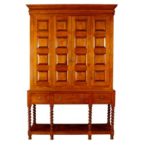 Shown in tiger maple, the William & Mary-style entertainment center features barley-twist legs and raised paneling on the bi-fold doors.