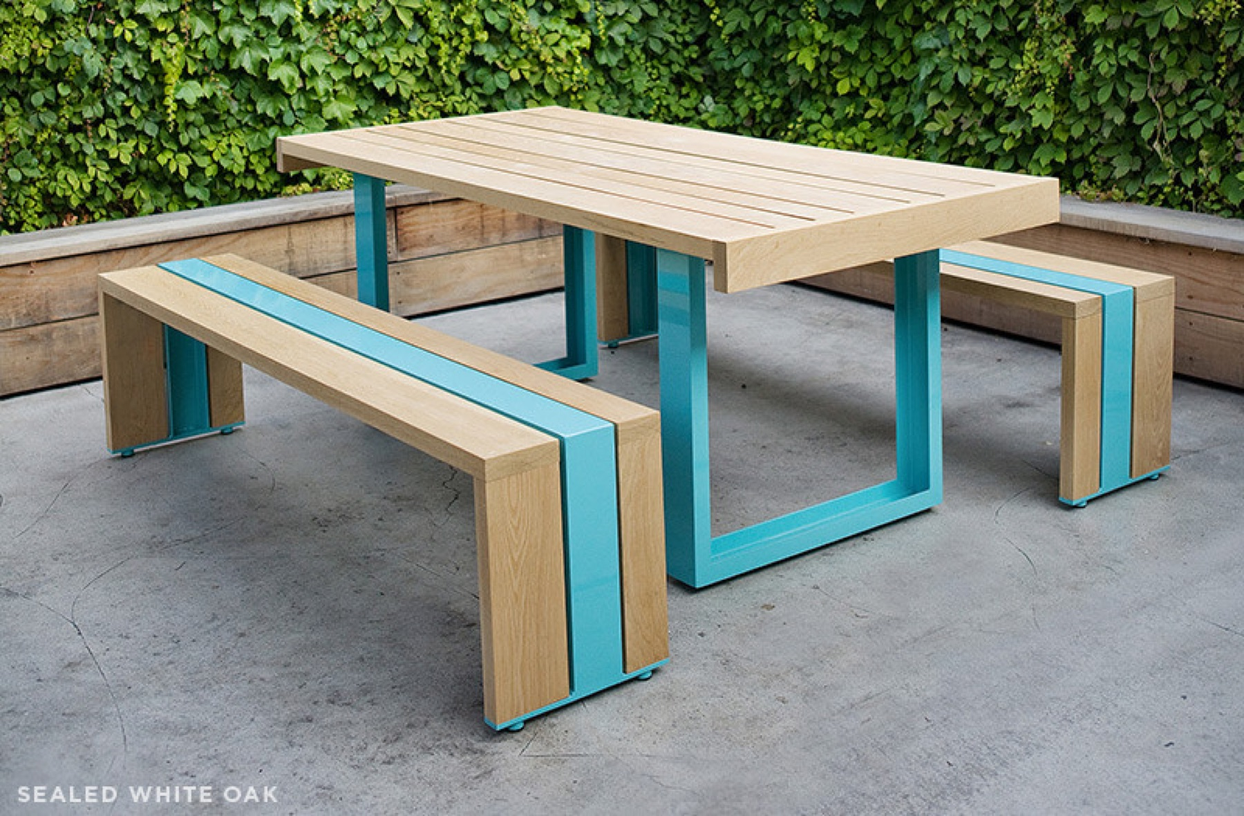 The SR Outdoor Table Set in American white oak and powder-coated aluminum from Scout Regalia. Photograph by Dylan + Jeni.