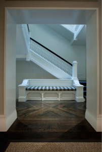 Dark stained white-oak chevron floor in the stair hall of a 1920s Chicago Gold Coast limestone mansion renovated by Michael Abrams Limited