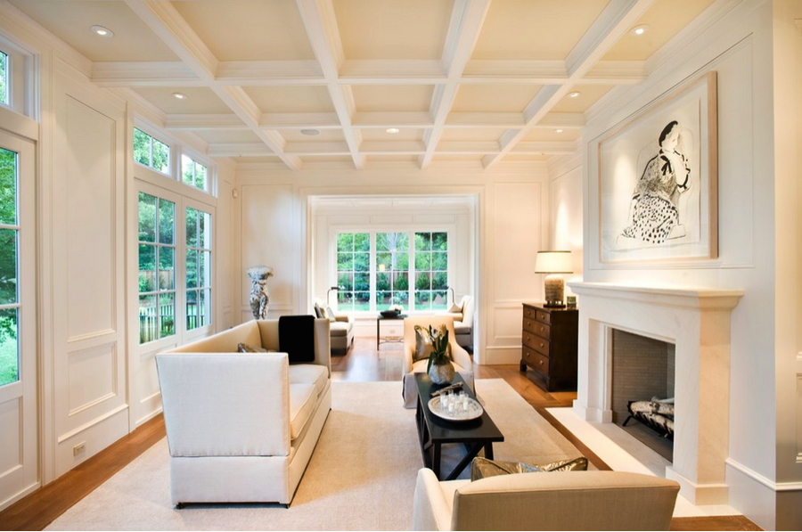An unobtrusive coffered ceiling helps create low key