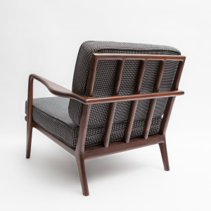 The Rail Back Armchair in solid American black walnut from Smilow Design